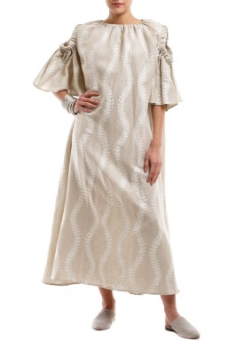 Leaves branches on beige kaftan