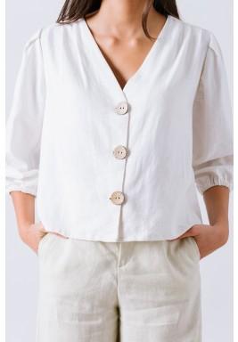 قميص أبيض مائل إلى الصفرة بأزرار على طول القميص