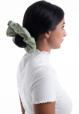 ربطة شعر خضراء