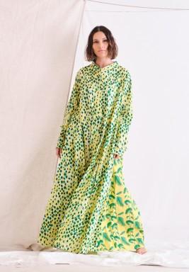 فستان أصفر ماكسي بطبعات خضراء