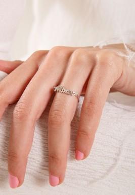 """خاتم من الذهب الأبيض بكتابة """" mine"""